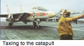F-14 taxi to the cat